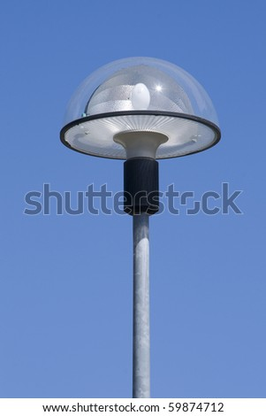 A modern street lamp isolated on a blue sky - stock photo