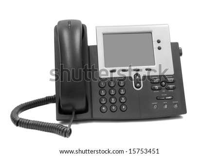 A modern telephone with display, speaker phone and hand held phone isolated on white.