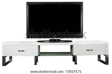 A modern white TV Cabinet with a large LCD TV on it. - stock photo