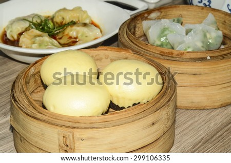 A modest meal of chinese dim sum in downtown chinatown / Dim sum / Today's modern dim sum restaurant caters to all walks of life and is halal to our muslim friends - stock photo