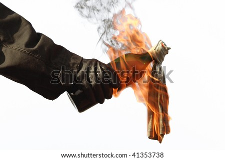 A molotov cocktail, ready for throwing - stock photo