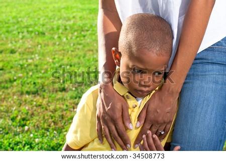 a mom comforts her sad child - stock photo
