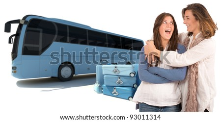 A mom hugging her teenage daughter with a shuttle bus and luggage on the background - stock photo
