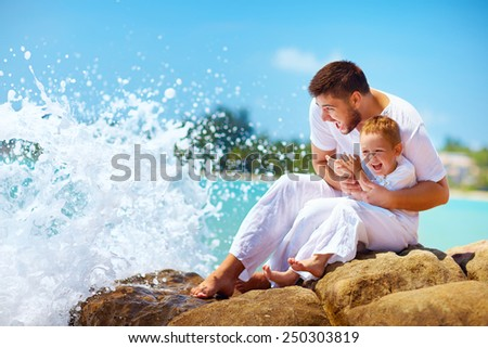 a moment before water splashing happy father and son - stock photo