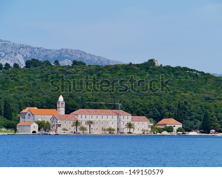 A monastery on the Croatian isle Badian in front of the island Korcula in the Adriatic sea of Croatia