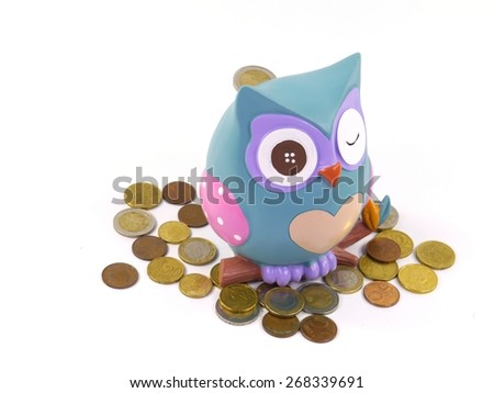 A  money box with euro coins over white - stock photo