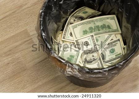 A money is in a trash bucket - stock photo