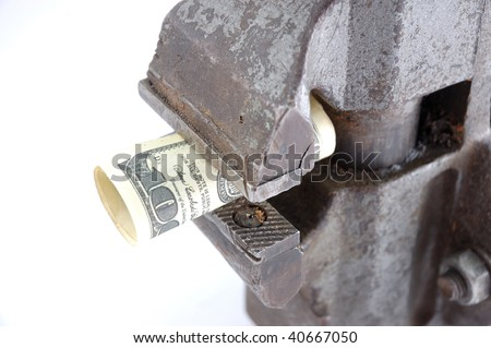 a money pinch-offs in vises - stock photo