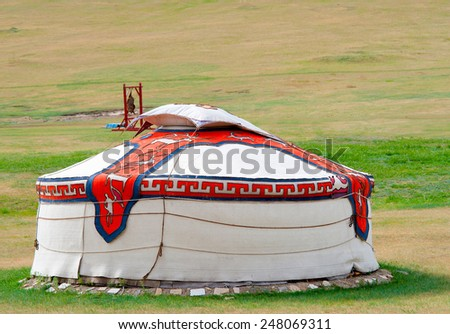 a mongolian coloured jurt encamped in steppe - stock photo
