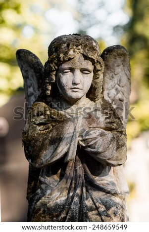 a monument of a sat angel on a graveyard - stock photo