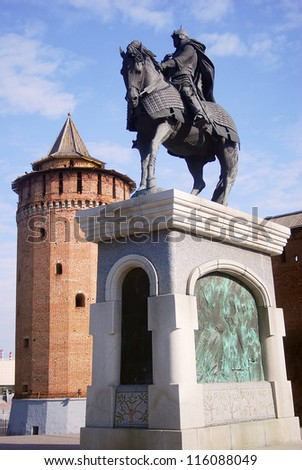 A monument to famous Russian historical figure Dmitry Donskoy and Kremlin tower and wall in Kolomna, Moscow region, Russia.