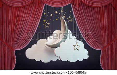 A moon and clouds stage set behind an opening Theater curtain - stock photo