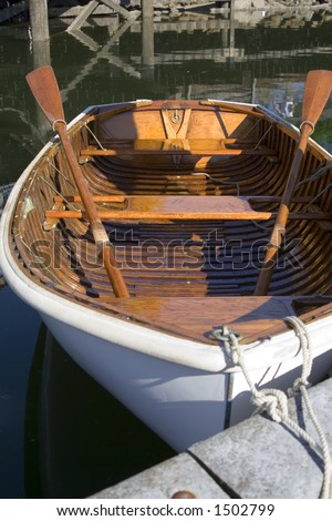 A moored wooden Life Boat. - stock photo