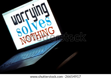 """a moral message, """"worrying solves nothing"""" on a laptop screen - stock photo"""