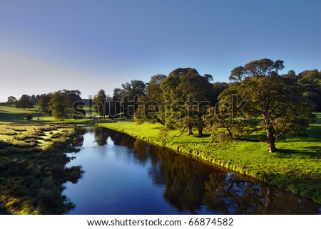 A Morning View of the River Bela at Dallam Park, Cumbria, England - stock photo