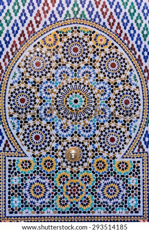 A Moroccan style water tap made with handmade mosaic - stock photo