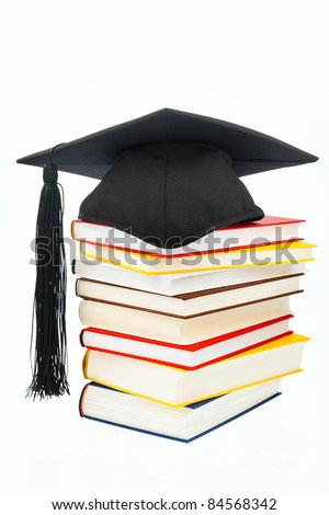 a mortarboard on a book stack on white background. icon image for costs in training and education - stock photo