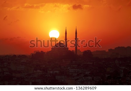 A mosque punctuates the Istanbul Skyline at sunset - stock photo