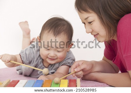 A Mother And A Baby - stock photo