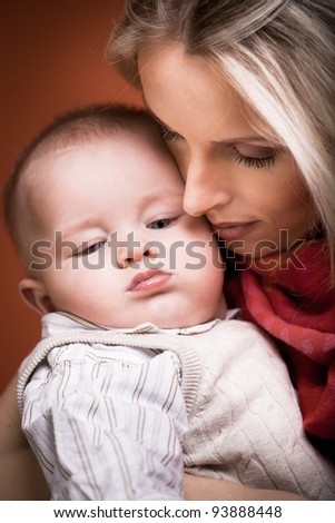 a mother and baby son studio portrait