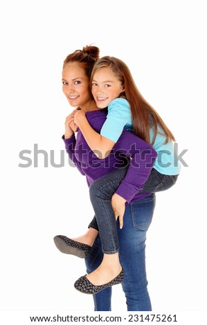 A mother and daughter playing for isolated white background, the girl sitting on the back of her mother.  - stock photo