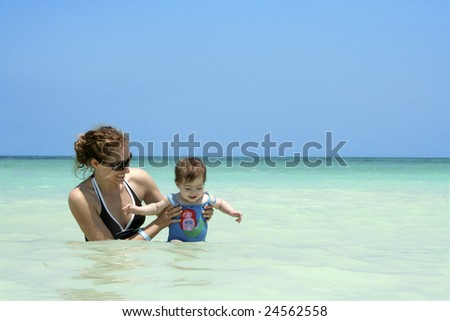 A mother and daughter playing in the Caribbean Ocean