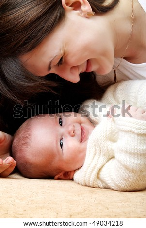 a mother and her baby girl - stock photo