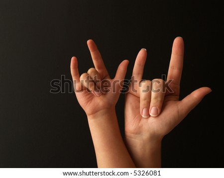 a mother and her child doing sign language for I LOVE YOU - stock photo