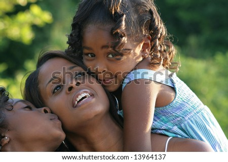 A mother and her daughters - stock photo