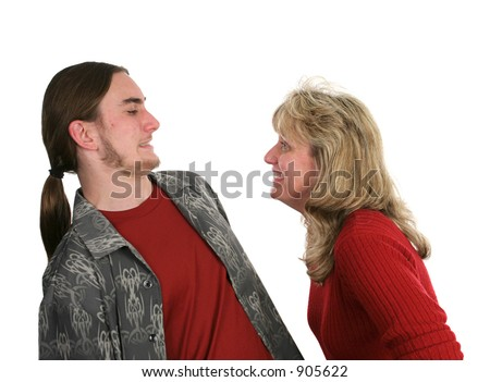 A mother and her teen son joking around with each other.