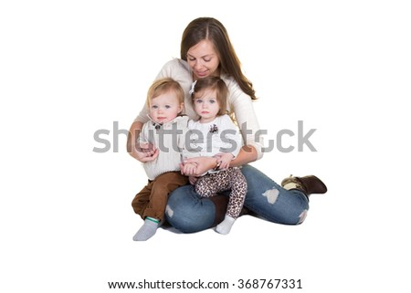 A mother and her toddler twins - stock photo
