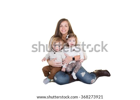 A mother and her twin toddlers - stock photo