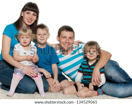 A mother, father, two sons and a daughter are on the white carpet - stock photo