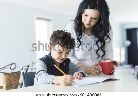 A Mother Helping Son for the Homework at home