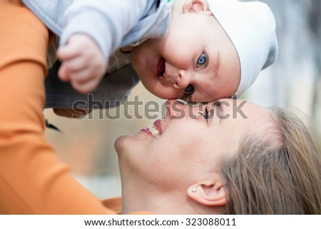 A mother hugging her cute little son - stock photo
