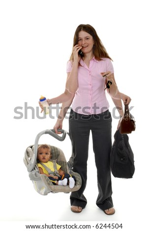 A mother multi-tasking with six occupied arms.  Focus on woman. - stock photo