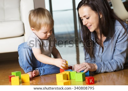 A mother play block with his son at home - stock photo