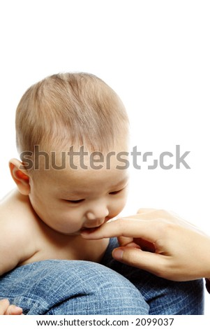 A mother playing with her baby son - stock photo