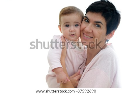 A mother playing with her little baby on white background