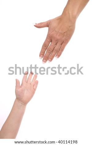 A mother reaching out and trying to grasp her child's hand. - stock photo