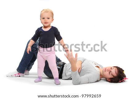 A mother teaching her child how to making first steps. Happy family concept. - stock photo