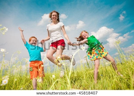 A mother with children goes on the field - stock photo