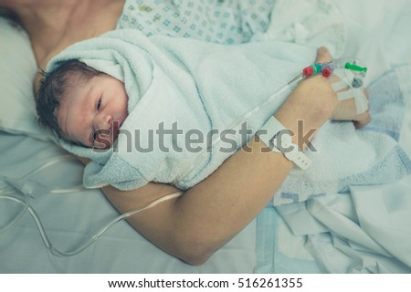 A mother with her newborn child in the hospital
