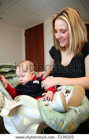 A mother with her son inside their home - stock photo