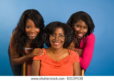 A mother with her two young adult daughters - stock photo