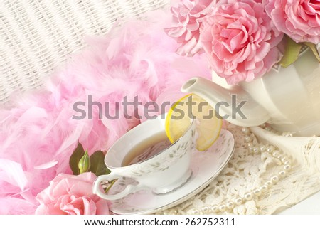 A Mothers Day tea party still life, with fresh hot tea with lemon, and fresh pink roses, plenty of space for text