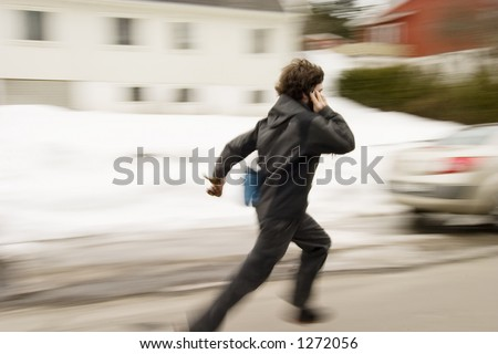 A motion blur abstract of a person walking in a hurry talking on a cell phone - stock photo