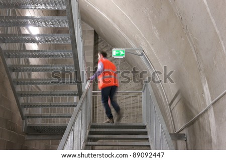 A motion blur abstract of a person walking ok the fire escape - stock photo