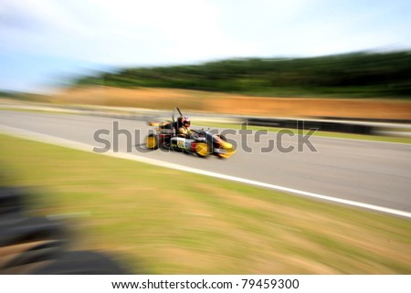 A motion blur of racing car - stock photo