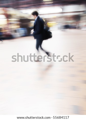 A motion blurred photo of Busy people travelling - stock photo